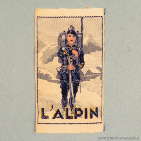 """INSIGNE TISSU FANTAISIE """"L'ALPIN"""" CHASSEUR ALPIN DES ANNEES 1930 A IDENTIFIER ??"""